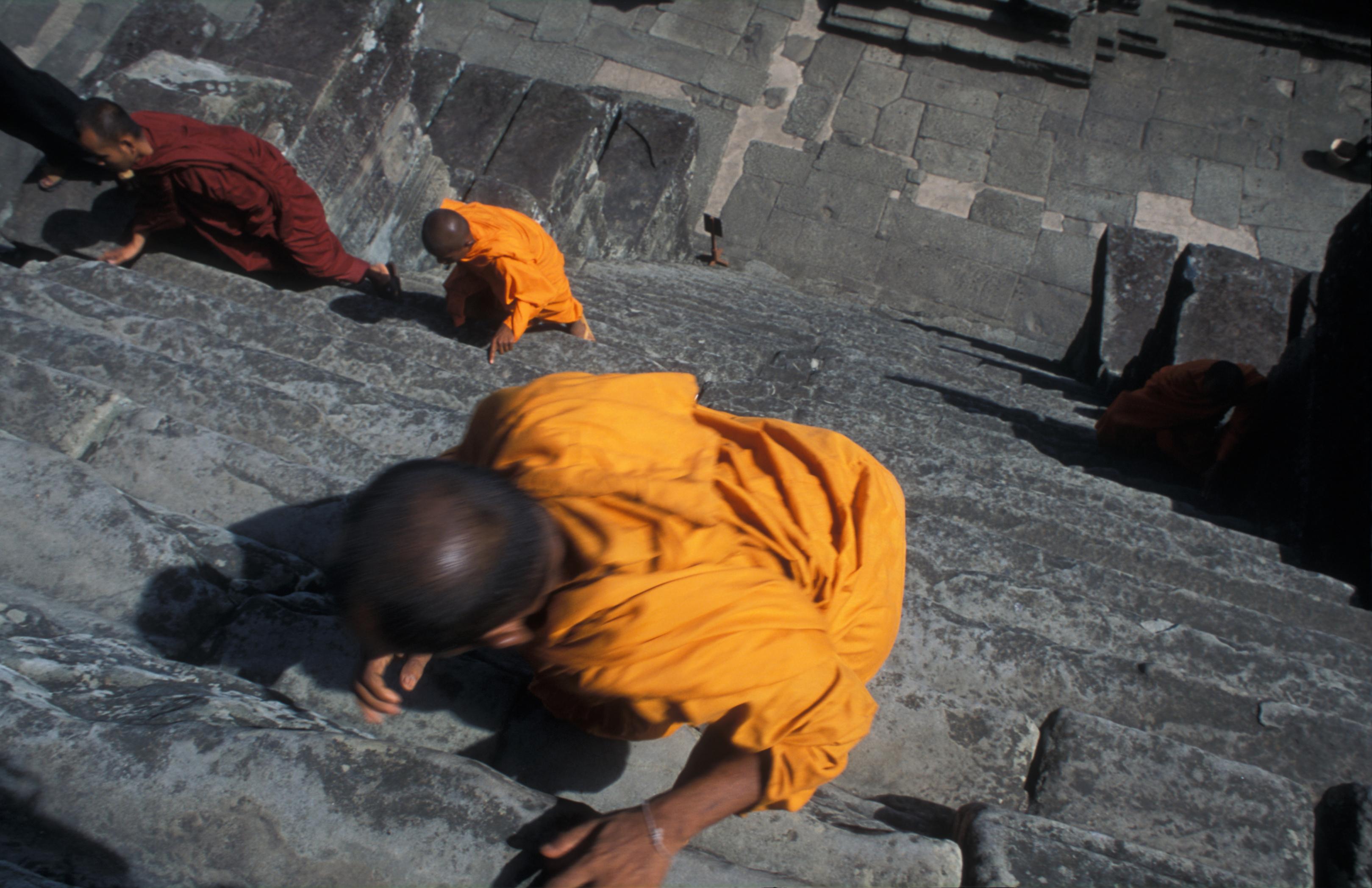 monks on the steps of Bayon Angkor